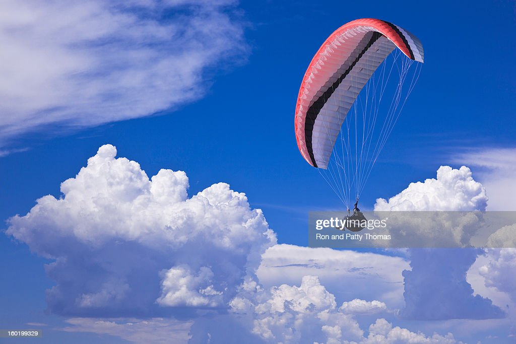 Paraglider with dramatic clouds at Torrey Pines, Southern California