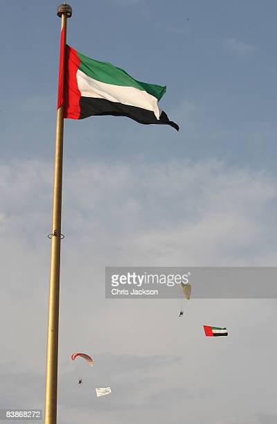 Paragliders fly past a giant UAE flag as part of Dubai National Day celebrations on December 1 2008 in Dubai United Arab Emirates National Day...