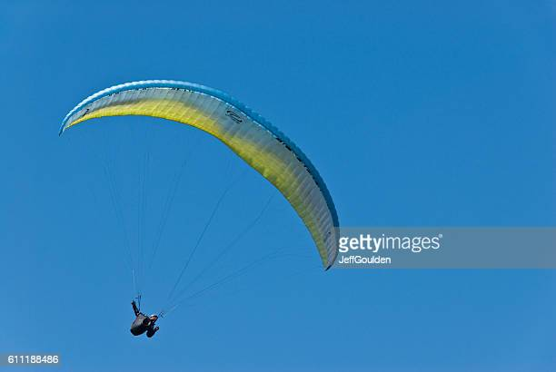 Paragliding in Clear Blue Sky