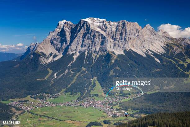 Paragliding in the Alps, Paraglider starting a flight, Mount Zugspitze, Alps