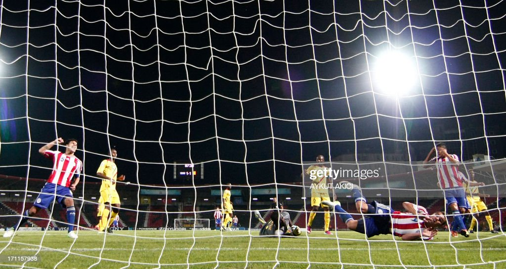 Paraguay and Mali's players are seen through the goal's net during the group stage football match between Mali and Paraguay at the FIFA Under 20 World Cup at the Kamil Ocak stadium in Gaziantep on June 22, 2013. AFP PHOTO/TURKPIX/Aykut AKICI