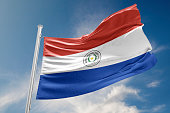 Paraguay flag is waving at a beautiful and peaceful sky in day time while sun is shining. 3D Rendering