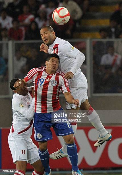 Paraguay forward Robin Ramírez and Peru's defender Alberto Rodríguez jump as they fight for the ball during the Brazil 2014 FIFA World Cup South...