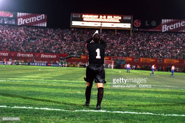 Paraguay goalkeeper Jose Luis Chilavert celebrates as the scoreboard proclaims the goal