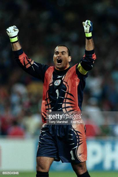 Paraguay goalkeeper Jose Luis Chilavert celebrates their qualification for the second round at the end of the match