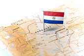 The flag of Paraguay pinned on the map. Horizontal orientation. Macro photography.