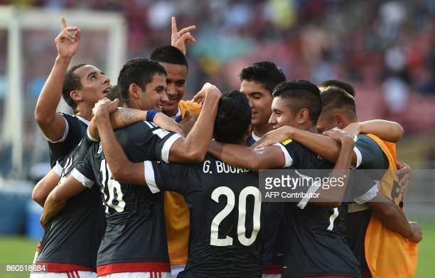 Paraguay players celebrate after scoring a goal during the group stage football match between Turkey and Paraguay in the FIFA U17 World Cup at the...