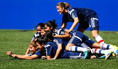 Paraguay players pile on top of one another for a photo prior to their FIFA U20 Women's World Cup Canada 2014 Group D training at Commonwealth...
