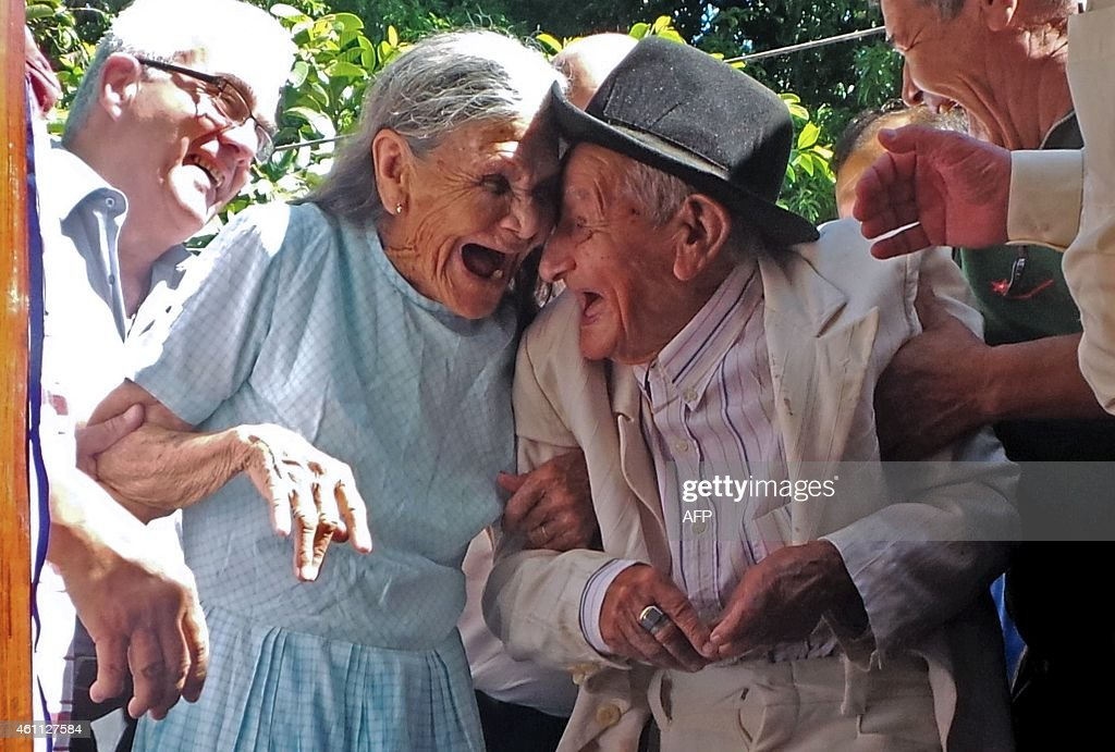 Paraguayan Anacleto Escobar veteran of the Chaco War fought between Paraguay and Bolivia and his wife Cayetana Roman smile during a ceremony...