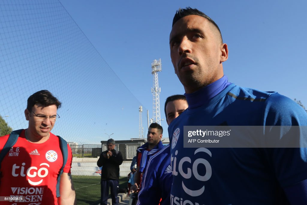 Paraguayan footballer Lucas Barrios is seen before a training session at the Monumental stadium in Santiago, on August 30, 2017, ahead of their 2018 FIFA Russia World Cup qualifier football match against Chile. /