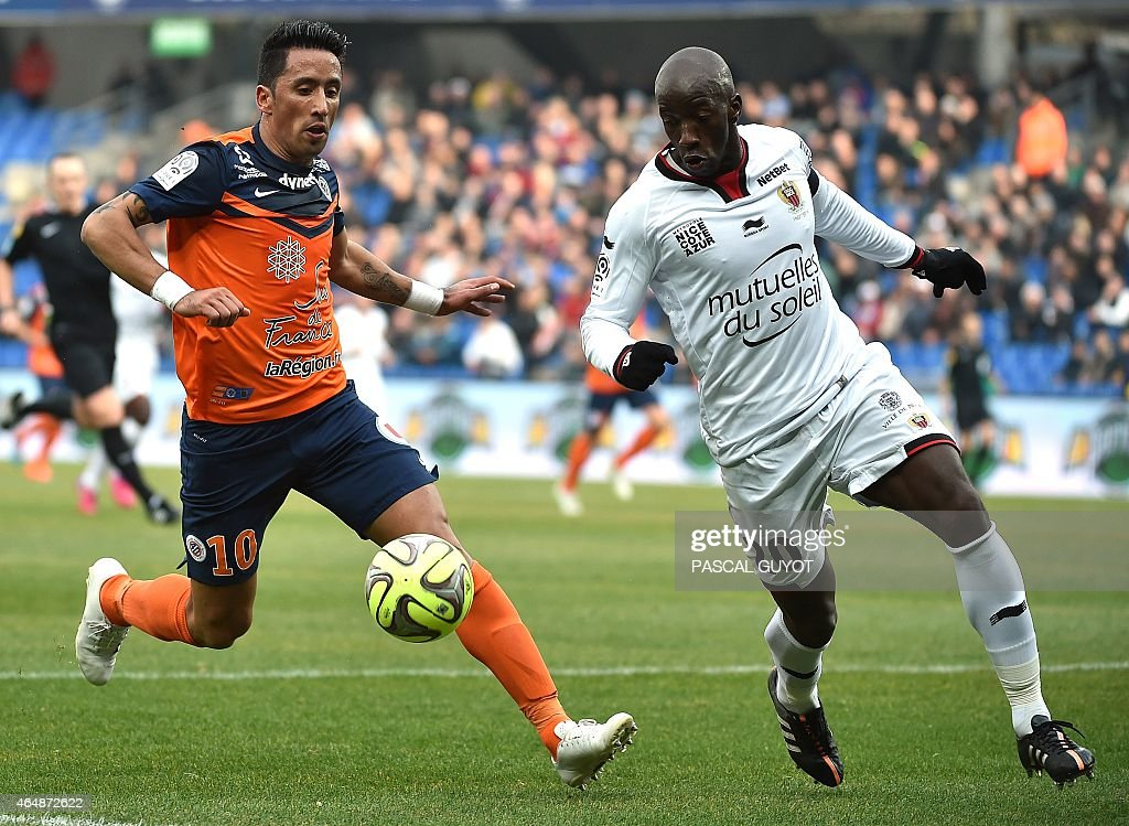 Paraguayan forward <a gi-track='captionPersonalityLinkClicked' href=/galleries/search?phrase=Lucas+Barrios&family=editorial&specificpeople=4142497 ng-click='$event.stopPropagation()'>Lucas Barrios</a> (L) vies for the ball with Nice's Senegalese midfielder <a gi-track='captionPersonalityLinkClicked' href=/galleries/search?phrase=Souleymane+Diawara&family=editorial&specificpeople=695613 ng-click='$event.stopPropagation()'>Souleymane Diawara</a> (R) during the French L1 football match between Montpellier (MHSC) and Nice (OGNC) on March 1, 2015 at the la Mosson Stadium in Montpellier, southern France.