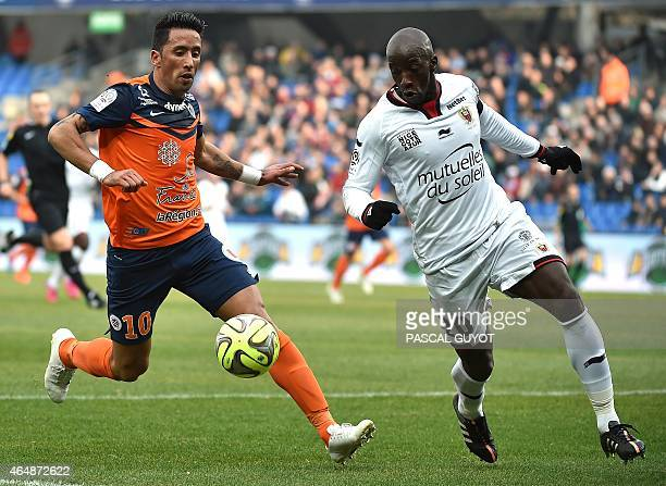 Paraguayan forward Lucas Barrios vies for the ball with Nice's Senegalese midfielder Souleymane Diawara during the French L1 football match between...