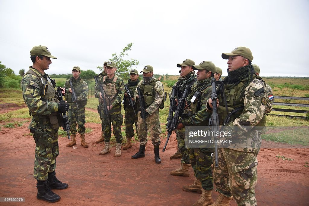 Paraguayan Joint Task Force troops are briefed before patrolling the Arroyito sector department of Concepcion Paraguay on August 29 2016 searching...