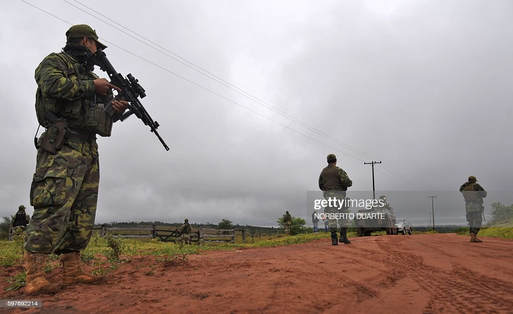 Paraguayan Joint Task Force troops man a checkpoint on a dirt road in the Arroyito sector department of Concepcion Paraguay on August 29 2016...
