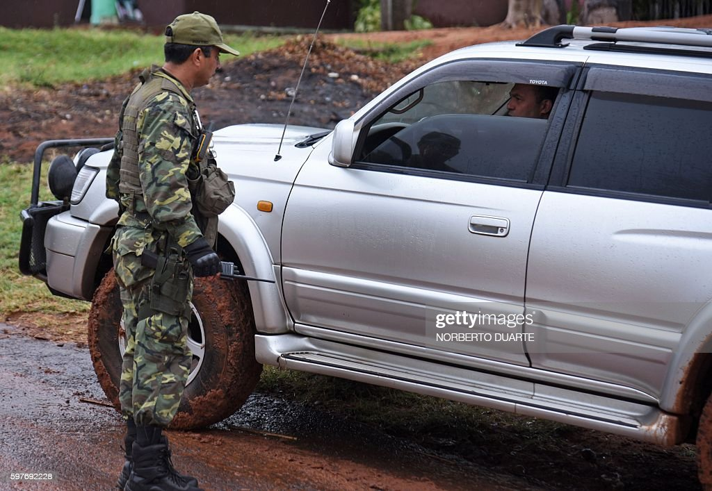 Paraguayan Joint Task Force troops man a checkpoint on road in the Arroyito sector department of Concepcion Paraguay on August 29 2016 searching for...