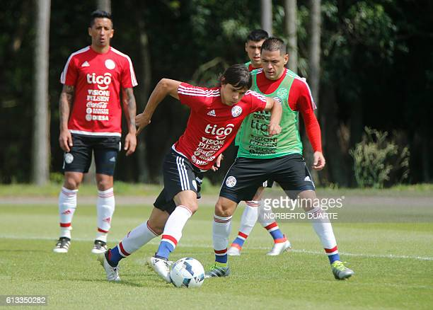 Paraguayan national football team player Oscar Romero controls the ball during a training session at the Complejo Albiroga training centre in Ypane...