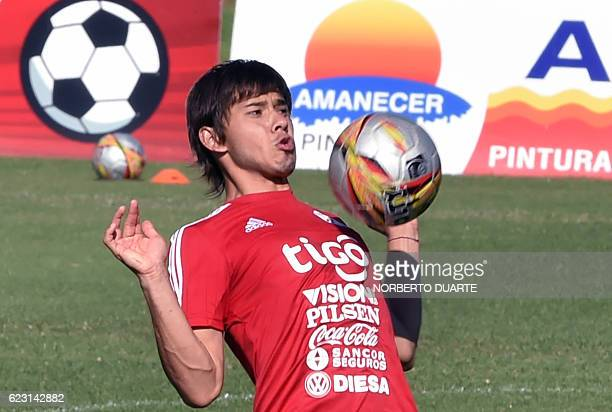 Paraguayan national football team player Oscar Romero takes part in a training session at the Complejo Albiroga training centre in Ypane Paraguay on...