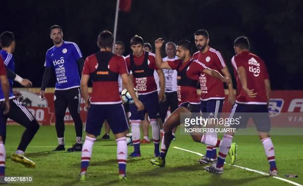 Paraguayan national football team players Angel Romero Cecilio Dominguez and Santiago Salcedo take part in a training session at the Complejo...