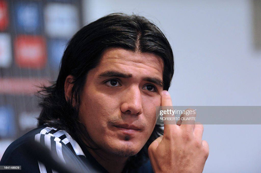 Paraguayan national team footballer Fidencio Oviedo speaks during a press conference in Ypane, near Asuncion, on March 20, 2013. Paraguay will face Uruguay on march 22 in Montevideo in a Brazil 2014 FIFA World Cup South American qualifier.
