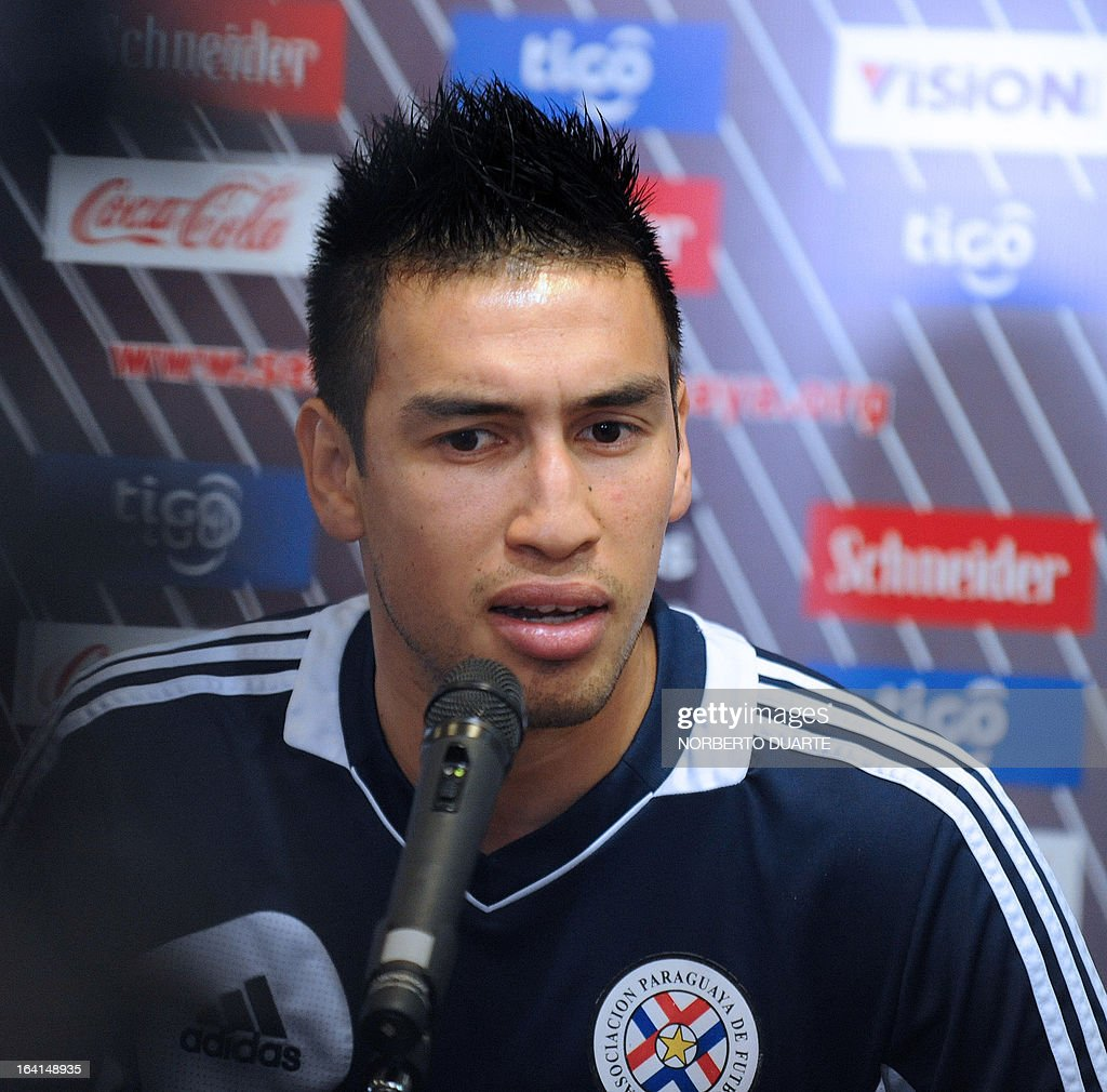 Paraguayan national team footballer Marcelo Estigarribia speaks during a press conference in Ypane, near Asuncion, on March 20, 2013. Paraguay will face Uruguay on march 22 in Montevideo in a Brazil 2014 FIFA World Cup South American qualifier. AFP PHOTO/NORBERTO DUARTE