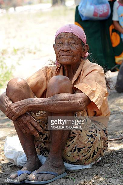 A Paraguayan native from the Comunidad Esperanza in Chaco 240 km north of Asuncion waits for supplies from the UN World Food Programme on October 2...