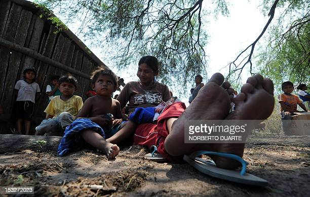 Paraguayan natives from the Comunidad Esperanza in Chaco 240 km north of Asuncion wait for supplies from the UN World Food Programme on October 2...