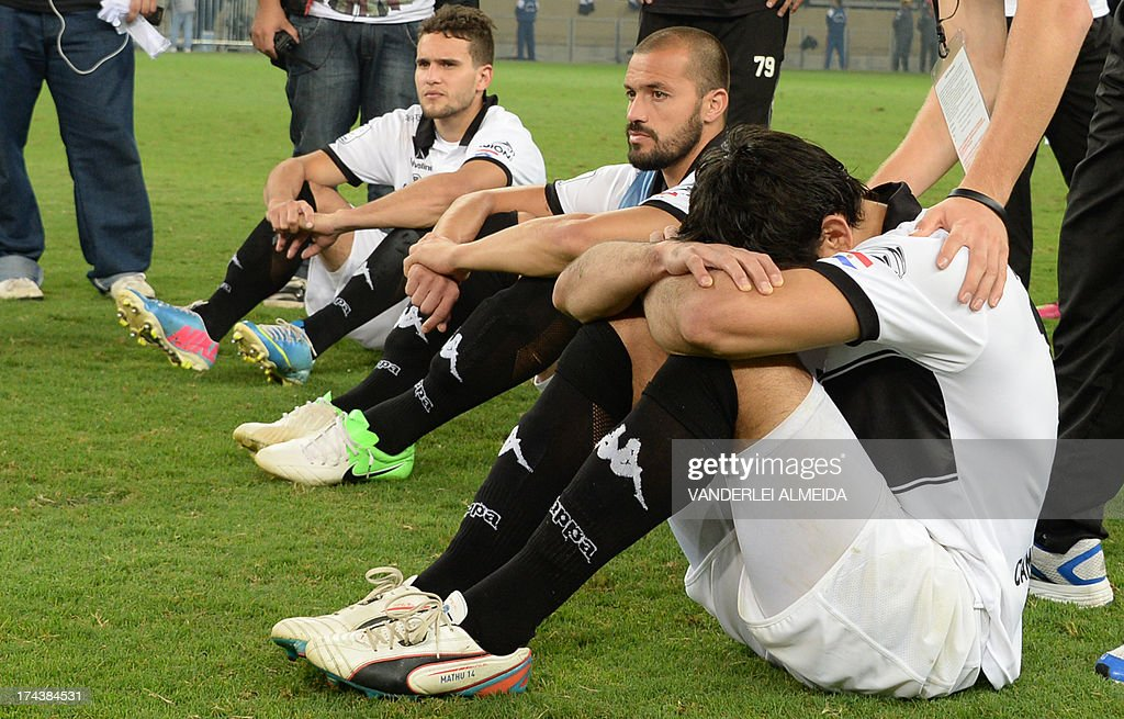 Paraguayan Olimpia players react after losing their Libertadores Cup second leg final football match shoot-out against Brazilian Atletico Mineiro at the Mineirao stadium in Belo Horizonte, Brazil on July 24, 2013. Atletico Mineiro won by 4-3 after a penalty shoot-out.