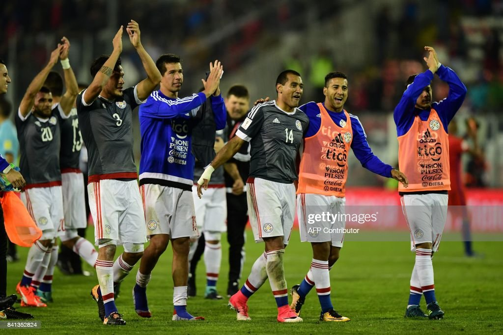 Paraguayan players celebrate after defeating Chile 3-0 during their 2018 World Cup qualifier football match, in Santiago, on August 31, 2017. /