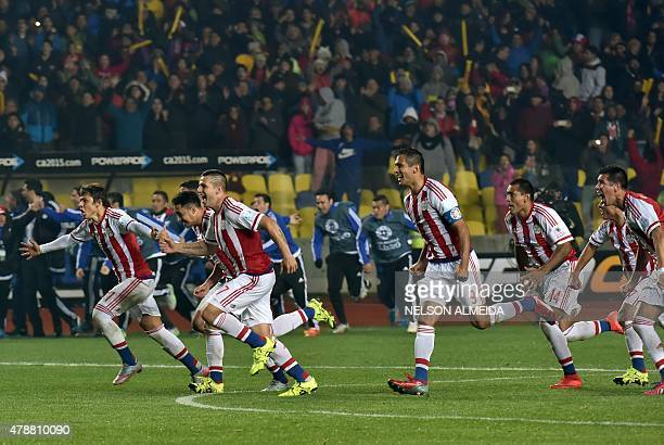 Paraguayan players celebrate after winning their 2015 Copa America football championship quarterfinal match against Brazil in Concepcion Chile on...