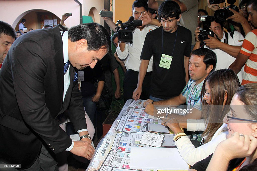 Paraguayan President Federico Franco casts his vote at a polling station in Asuncion on April 21 2013 Voters in Paraguay cast ballots Sunday to...