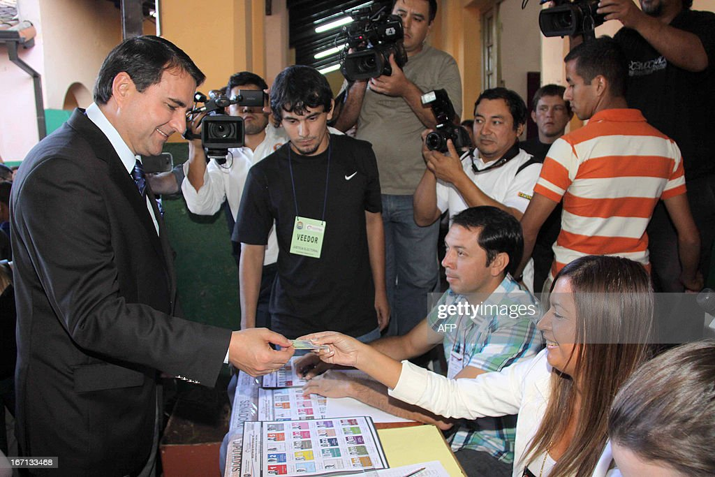 Paraguayan President Federico Franco (L) is seen at a polling station in Asuncion on April 21, 2013. Voters in Paraguay cast ballots Sunday to choose a new leader and try to turn the page on a political crisis that saw the impeachment of leftist president Fernando Lugo ten months ago. AFP PHOTO/Jorge Romero