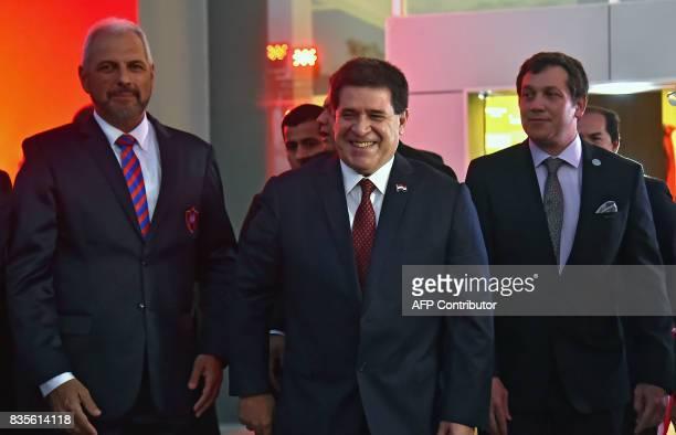 Paraguayan President Horacio Cartes the president of the Cerro Porteno football club Juan Jose Zapac and Alejandro Dominguez president of CONMEBOL...