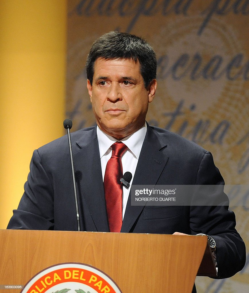 Paraguayan presidential candidate for the Colorado party, Horacio Cartes, gestures just before the start of a televised presidential debate on March 17, 2013 in Asuncion. Paraguay will hold presidential elections next April 21. AFP PHOTO/Norberto Duarte