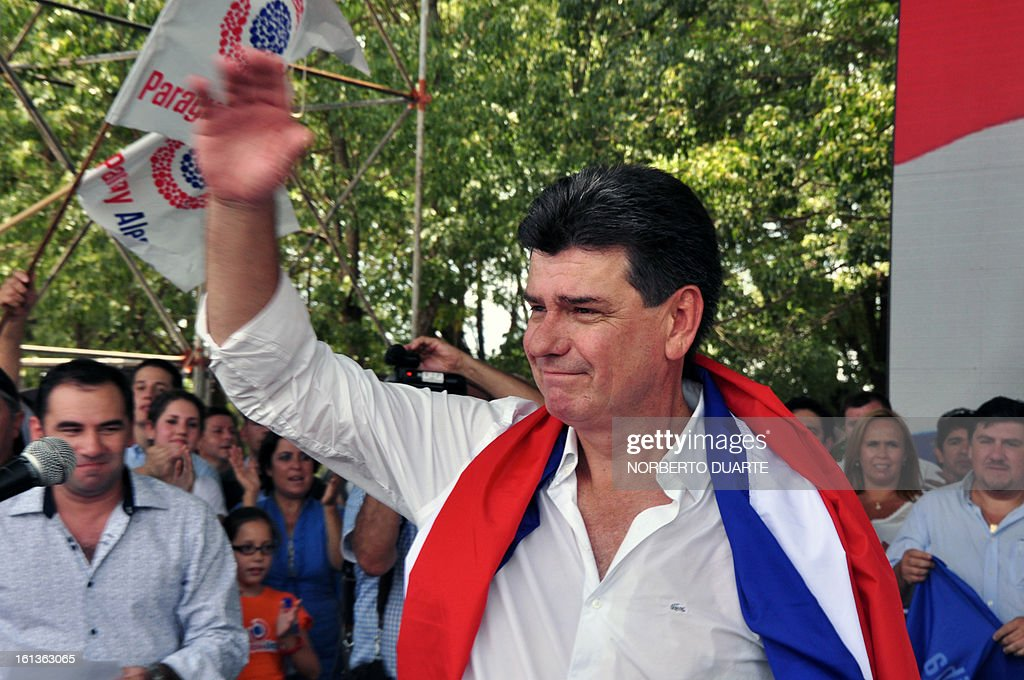 Paraguayan presidential candidate for the Liberal Party, Efrain Alegre, waves at supporters during a rally to initiate his electoral campaign in Coronel Oviedo, 130 km from Asuncion, on February 10, 2013. Paraguay will hold presidential elections on April 21, 2013. AFP PHOTO/Norberto Duarte