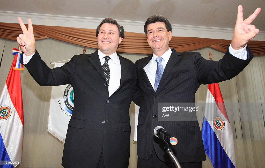 Paraguayan presidential candidate for the Liberal party, Efrain Alegre (R) and vice presidential candidate Rafael Filizzola flash the 'v' sign during their registration of candidacies on February 13, 2013 in Asuncion. Paraguay will hold its presidential elections next April 21. AFP PHOTO/ Christian Alvarenga