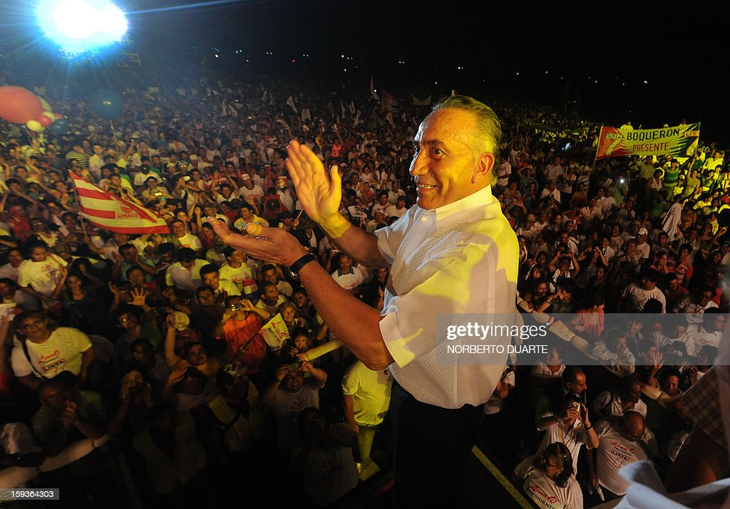 Paraguayan presidential candidate for the National Union of Ethical Citizens (UNACE) party, Lino Oviedo, is greeted by supporters during a rally for the initiation of his political campaign in Luque, Paraguay on, January 12 , 2013. Paraguay will hold presidential elections on April 21, 2013. AFP PHOTO/Norberto Duarte