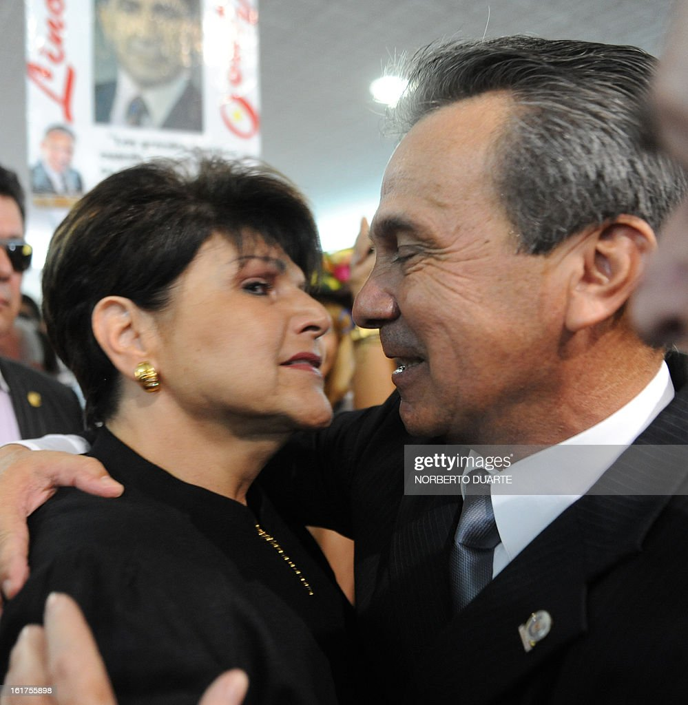 Paraguayan presidential candidate for the (UNACE) party, Lino Cesar Oviedo (R) and Raquel Marin, widow of late General Lino Oviedo, hug each other during the former's registration of his candidacy on February 15, 2013 in Asuncion. Paraguay will hold its presidential elections next April 21