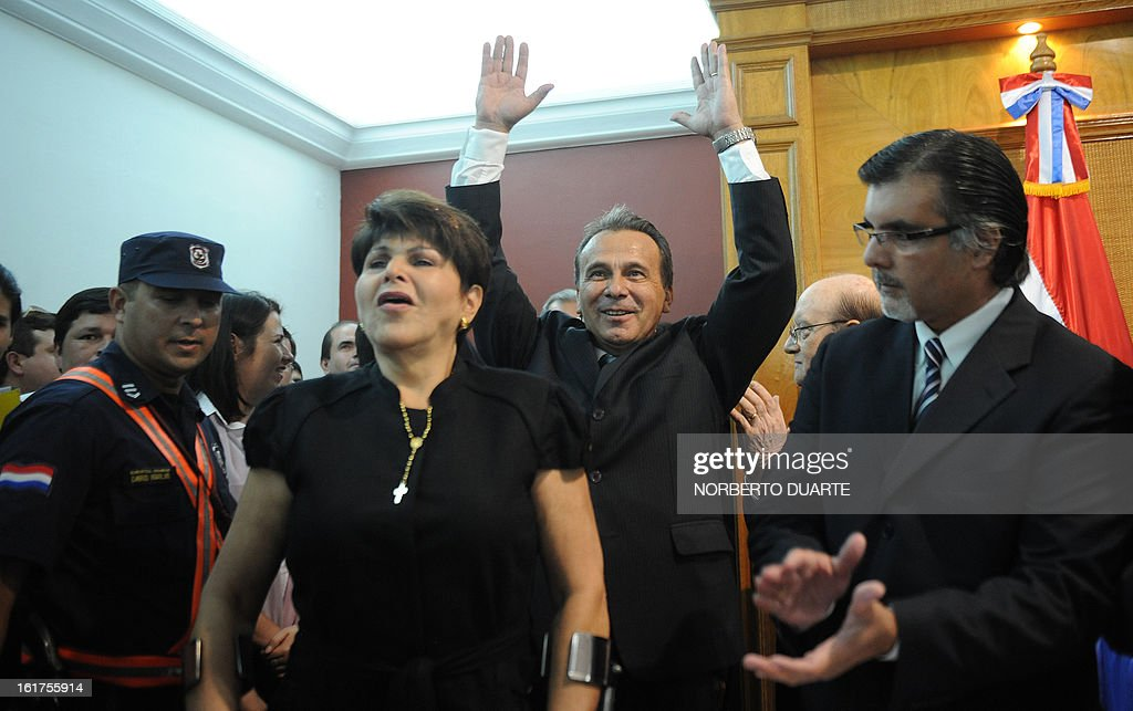 Paraguayan presidential candidate for the (UNACE) party, Lino Cesar Oviedo (C) and Raquel Marin (L), widow of late General Lino Oviedo, cheer during the former's registration for his candidacy on February 15, 2013 in Asuncion. Paraguay will hold its presidential elections next April 21