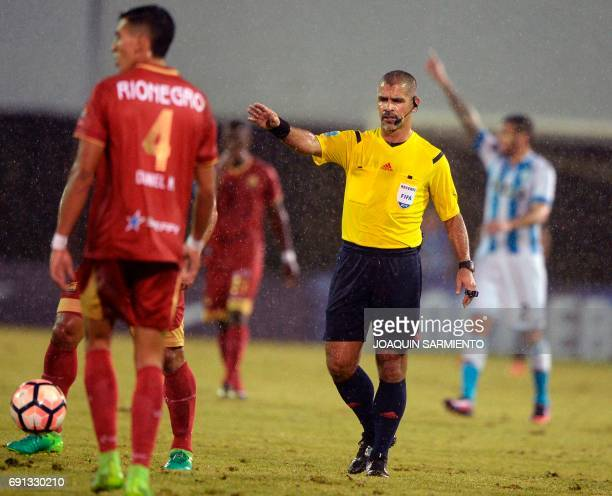 Paraguayan referee Eber Aquino gestures during the 2017 Copa Sudamericana football match between Colombia´s Rionegro Aguilas and Argentina´s Racing...