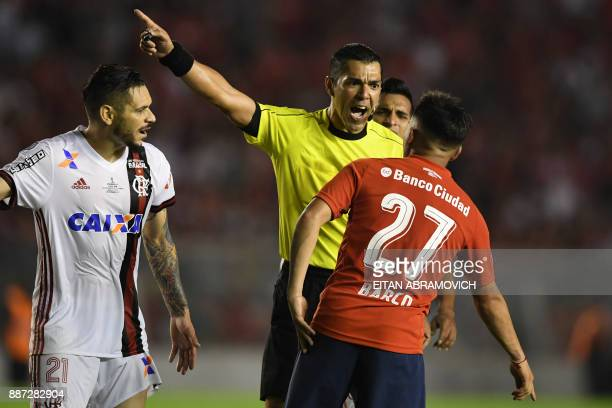 Paraguayan referee Mario Diaz argues with Argentina's Independiente midfielder Ezequiel Barco during the Copa Sudamericana first leg football final...