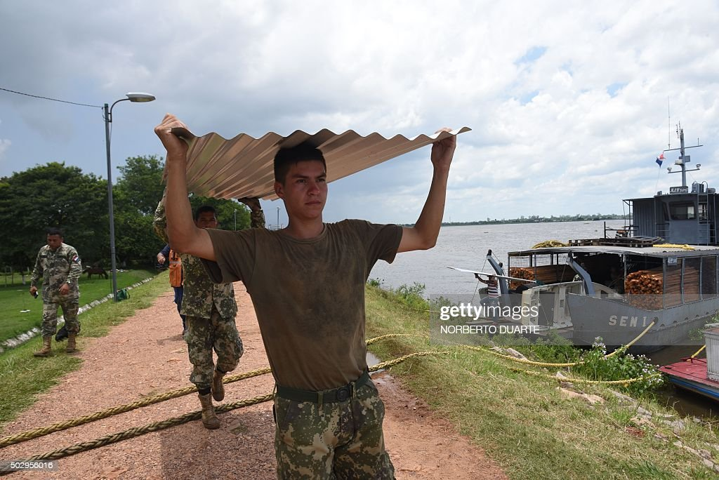 Paraguayan soldiers during rescue and aid operations in Alberdi 130 km south of Asuncion on December 30 2015 Storms and floods battering South...