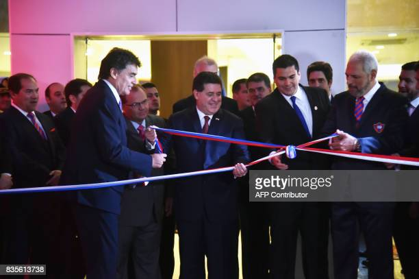 Paraguayan Sports Minister Victor Manuel Pecci and President Horacio Cartes the president of Paraguay's football association Robert Harrison and the...