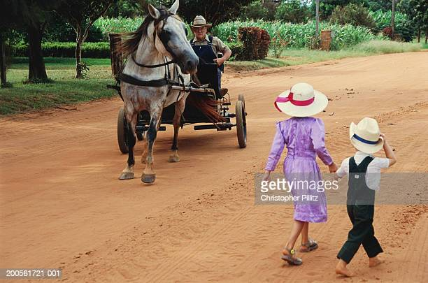 Paraguay,Rio Verde,Mennonite brother and sister walking on dirt road