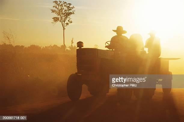 Paraguay,Rio Verde,Mennonite territory,tractor in field in setting sun