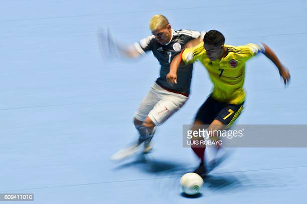 TOPSHOT Paraguay's Adolfo Salas vies for the ball with Colombia's Jhonatan Toro during their Colombia 2016 FIFA Futsal World Cup match in Cali...