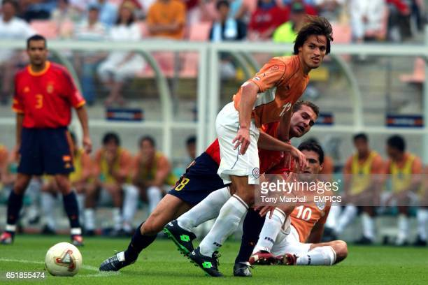 Paraguay's Carlos Paredes is tackled by Spain's Ruben Baraja
