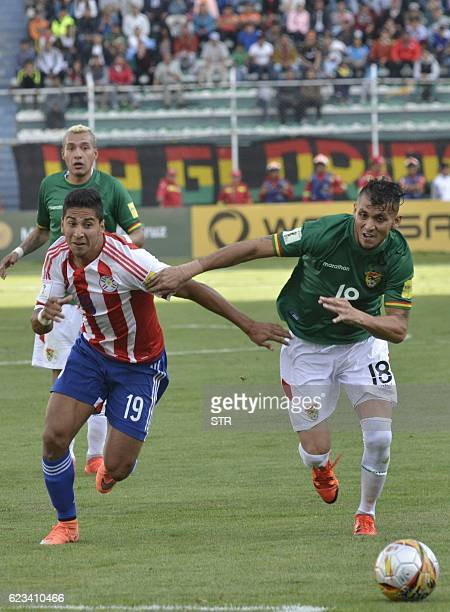 Paraguay's Cecilio Dominguez and Bolivia's Yasmani Duk vie for the ball during their 2018 FIFA World Cup qualifier football match in La Paz on...