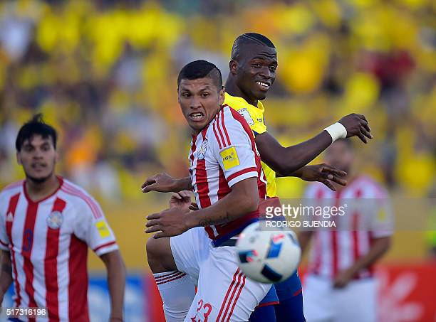 Paraguay's Celso Ortiz and Ecuador's Enner Valencia eye the ball during their Russia 2018 FIFA World Cup South American Qualifiers' football match in...