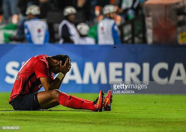 Paraguay's Cerro Cecilio Dominguez reacts after missing a goal opportunity against Colombia's Nacional during their Sudamericana Cup second leg...