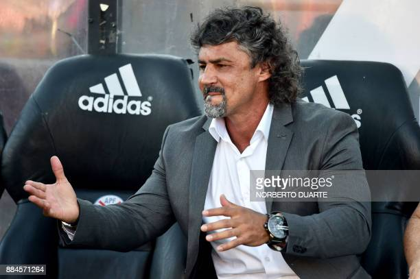 Paraguay's Cerro Porteno coach Leonel Alvarez gestures during the Paraguayan Clausura tournament final football match against Guarani on December 2...